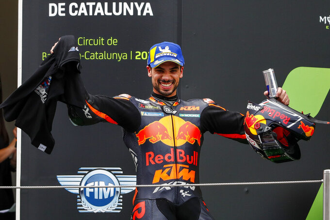 Portugal's Miguel Oliveira of KTM reacts from the podium after winning the Catalunya Motorcycle Grand Prix at the Barcelona Catalunya racetrack in Montmelo, near Barcelona, Spain, Sunday, June 6, 2021. (AP Photo/Joan Monfort)