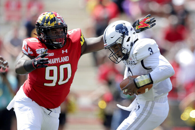 Maryland defensive lineman B'Ahmad Miller (90) moves in to sack Howard quarterback Caylin Newton (3) during the first half of an NCAA college football game, Saturday, Aug. 31, 2019, in College Park, Md. (AP Photo/Julio Cortez)