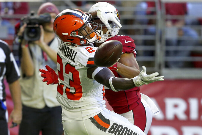 Cleveland Browns free safety Damarious Randall (23) interferes with Arizona Cardinals wide receiver Christian Kirk for a penalty for a first down during the second half of an NFL football game, Sunday, Dec. 15, 2019, in Glendale, Ariz. (AP Photo/Ross D. Franklin)
