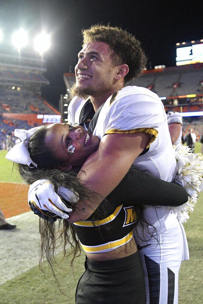 Missouri safety Cam Hilton (7) celebrates with a cheerleader after an NCAA college football game against Florida, Saturday, Nov. 3, 2018, in Gainesville, Fla. (AP Photo/Phelan M. Ebenhack)