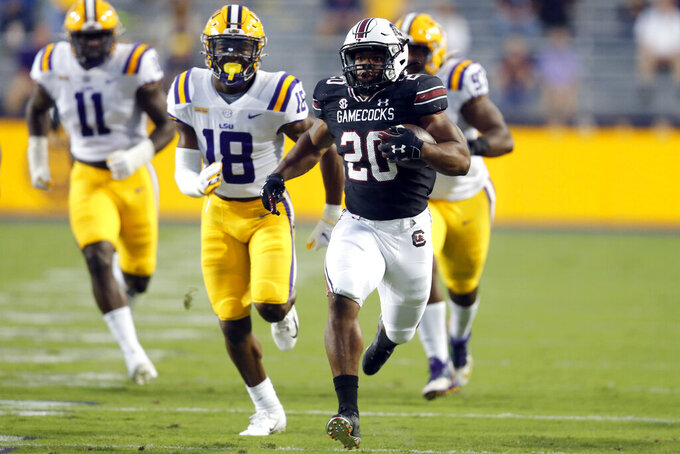 South Carolina running back Kevin Harris (20) runs the ball for a touchdown against LSU during the first half of an NCAA college football game in Baton Rouge, La. Saturday, Oct. 24, 2020. (AP Photo/Brett Duke)