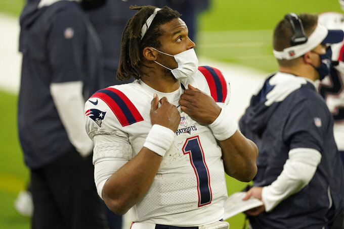 New England Patriots quarterback Cam Newton watches from the sideline after being pulled from the game during the second half of an NFL football game against the Los Angeles Rams Thursday, Dec. 10, 2020, in Inglewood, Calif. (AP Photo/Ashley Landis)