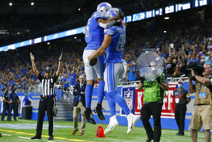 Detroit Lions tight end T.J. Hockenson (88) celebrates with Tyrell Williams (6) after his six yard touchdown reception against the San Francisco 49ers in the first half of an NFL football game in Detroit, Sunday, Sept. 12, 2021. (AP Photo/Duane Burleson)