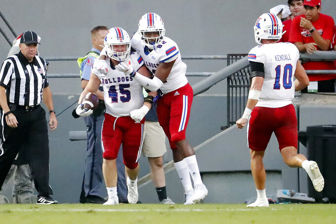 Louisiana Tech's Jacob Adams (45) is congratulated on a touchdown by teammate Ivan Thomas (82) and Austin Kendall (10) during the first half of an NCAA college football game against North Carolina State in Raleigh, N.C., Saturday, Oct. 2, 2021. (AP Photo/Karl B DeBlaker)