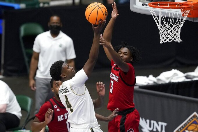 Colorado State guard Isaiah Stevens (4) shoots over North Carolina State guard Cam Hayes (3) during the second half of an NCAA college basketball game in the quarterfinals of the NIT, Thursday, March 25, 2021, in Frisco, Texas. (AP Photo/Tony Gutierrez)