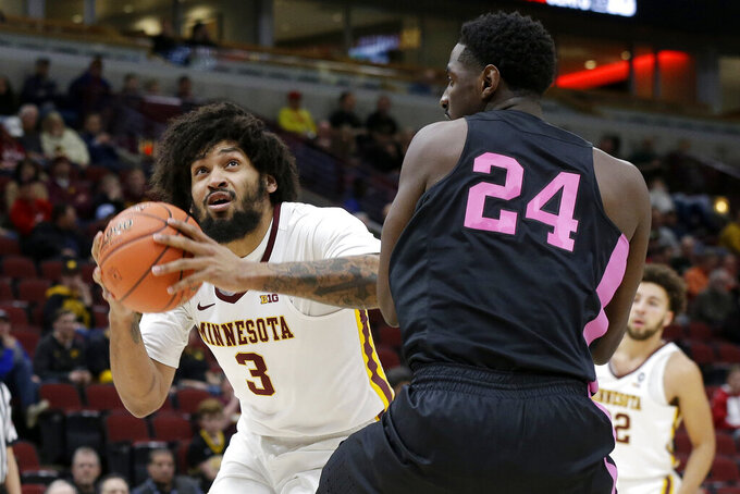 Minnesota's Jordan Murphy (3) drives against Penn State's Mike Watkins (24) during the first half of an NCAA college basketball game in the second round of the Big Ten Conference tournament, Thursday, March 14, 2019, in Chicago. (AP Photo/Kiichiro Sato)