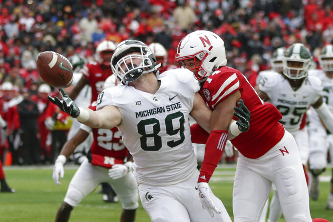 Michigan State tight end Matt Dotson (89) can't hold on to the ball in the end zone in front of Nebraska defensive back Tre Neal (14) during the first half of an NCAA college football game in Lincoln, Neb., Saturday, Nov. 17, 2018. (AP Photo/Nati Harnik)