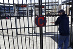 Jason Hackedorn looks into Progressive Field, home of the Cleveland Indians baseball team, March 26, 2020, in Cleveland. (AP Photo/Tony Dejak)