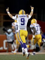 LSU quarterback Joe Burrow (9) celebrates a touchdown against Texas during an NCAA football game on Saturday, Sept. 7, 2019, in Austin, Texas. (Nick Wagner/American-Statesman via AP)