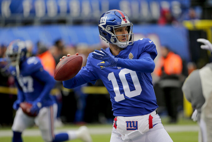 New York Giants quarterback Eli Manning (10) warms up before an NFL football game against the Miami Dolphins, Sunday, Dec. 15, 2019, in East Rutherford, N.J. (AP Photo/Seth Wenig)