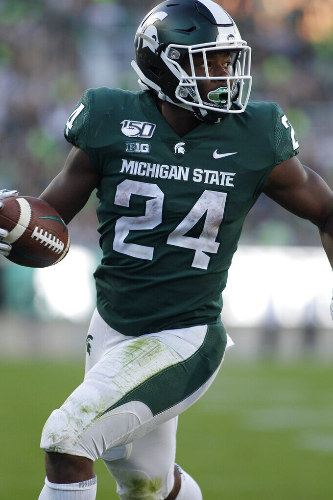 Michigan State's Elijah Collins rushes for a touchdown against Arizona State during the fourth quarter of an NCAA college football game Saturday, Sept. 14, 2019, in East Lansing, Mich. (AP Photo/Al Goldis)