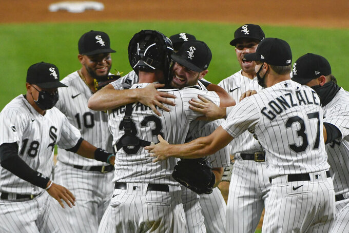 Chicago White Sox starting pitcher Lucas Giolito, center, celebrates with teammates after closing out a no-hitter in the team's baseball game against the Pittsburgh Pirates, Tuesday, Aug. 25, 2020, in Chicago. (AP Photo/Matt Marton)