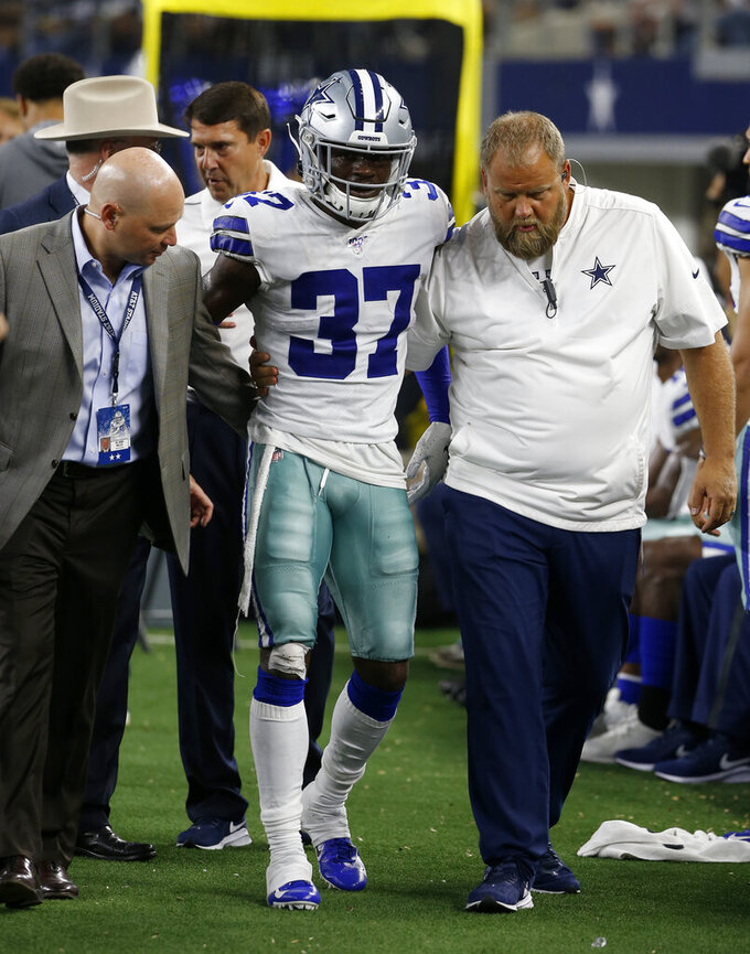 Dallas Cowboys defensive back Donovan Wilson (37) is assisted by team staff after suffering an unknown injury in the second half of a preseason NFL football game against the Tampa Bay Buccaneers in Arlington, Texas, Thursday, Aug. 29, 2019. (AP Photo/Ron Jenkins)