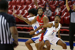SMU forward Feron Hunt (1) and guard Charles Smith IV, left, fight for position under the basket with Houston forward Justin Gorham, center, during the first half of an NCAA college basketball game in Dallas, Sunday, Jan. 3, 2021. (AP Photo/Roger Steinman)