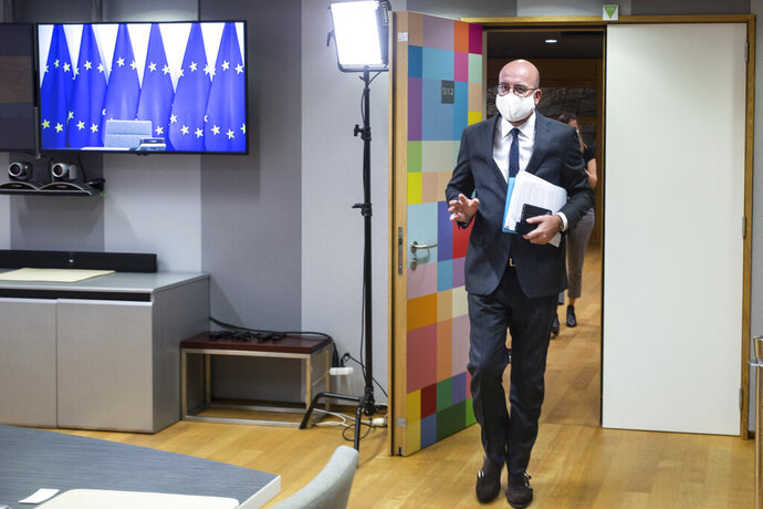 European Council President Charles Michel, wearing a protective face mask, arrives ahead of a video conference with German Chancellor Angela Merkel and Turkish President Recep Tayyip Erdogan at the European Council building in Brussels, Tuesday, Sept. 22, 2020. (Aris Oikonomou, Pool via AP)
