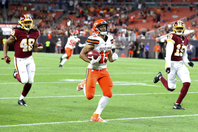 Cleveland Browns wide receiver Damon Sheehy-Guiseppi (15) runs for an 86-yard punt return during the second half of the team's NFL preseason football game against the Washington Redskins, Thursday, Aug. 8, 2019, in Cleveland. (AP Photo/Ron Schwane)