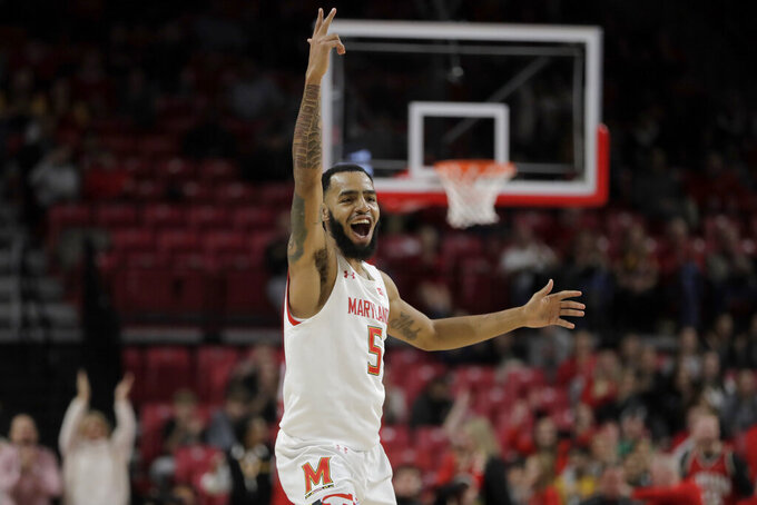 Maryland guard Eric Ayala reacts after scoring a basket against Rhode Island during the first half of an NCAA college basketball game, Saturday, Nov. 9, 2019, in College Park, Md. (AP Photo/Julio Cortez)