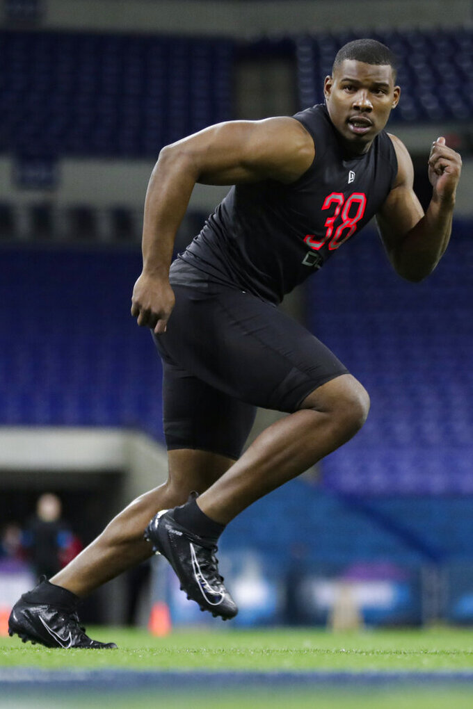 FILE - In this Feb. 29, 2020, file photo, Syracuse defensive lineman Alton Robinson runs a drill at the NFL football scouting combine in Indianapolis. In Darrell Taylor and Alton Robinson the Seattle Seahawks believe they could have their pass rushers of the future. (AP Photo/Michael Conroy, File)