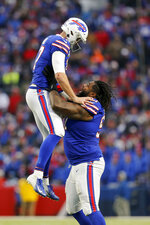 Buffalo Bills defensive tackle Jordan Phillips (97) celebrates with Buffalo Bills quarterback Josh Allen (17) after the Bills scored a touchdown against the Denver Broncos during the fourth quarter of an NFL football game, Sunday, Nov. 24, 2019, in Orchard Park, N.Y. (AP Photo/John Munson)