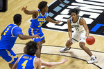 Michigan State's A.J. Hoggard (11) gets pressure from UCLA's Cody Riley (2), Jaime Jaquez Jr. (4) and David Singleton (34) during the first half of a First Four game in the NCAA men's college basketball tournament Thursday, March 18, 2021, at Mackey Arena in West Lafayette, Ind. (AP Photo/Robert Franklin)