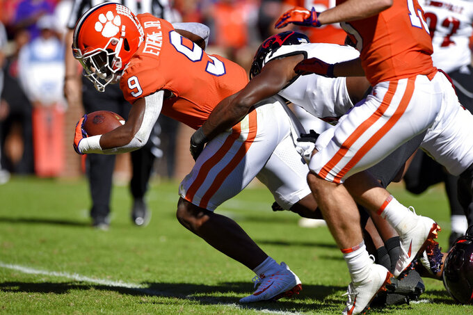 Clemson's Travis Etienne rushes in for a touchdown during the first half of an NCAA college football game against Louisville, Saturday, Nov. 3, 2018, in Clemson, S.C. (AP Photo/Richard Shiro)