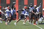 Cleveland Browns defensive back Greg Newsome II celebrates with teammates after an interception in 7 on 7 drills during an NFL football practice at the team's training facility, Thursday, June 17, 2021, in Berea, Ohio. (AP Photo/David Dermer)