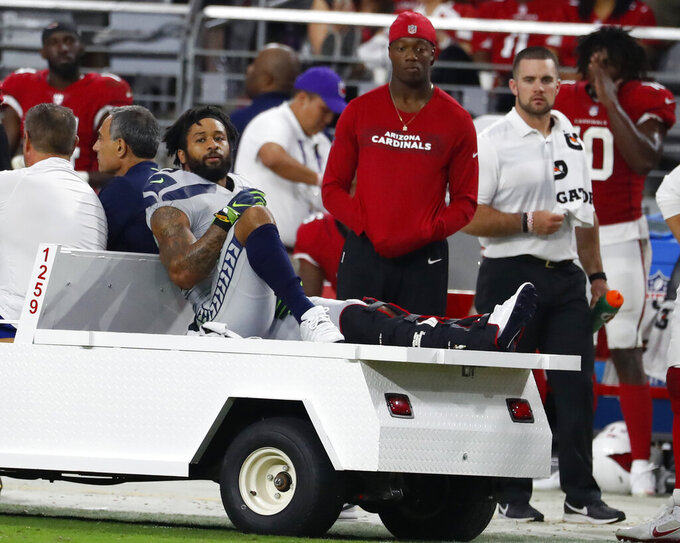FILE - In this Sept. 30, 2018, file photo, Seattle Seahawks defensive back Earl Thomas (29) during an NFL football game against the Arizona Cardinals in Glendale, Ariz. Thomas held out through the preseason for a new, cash-up-front, long-term contract in case of a serious injury. Thomas failed to get what he wanted and played instead under his soon-to-expire contract this year until he broke his leg in the fourth game of the season. (AP Photo/Rick Scuteri, File)