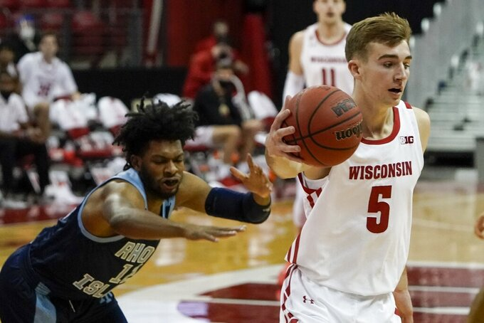 Wisconsin's Tyler Wahl drives past Rhode Island's Malik Martin during the first half of an NCAA college basketball game Wednesday, Dec. 9, 2020, in Madison, Wis. (AP Photo/Morry Gash)