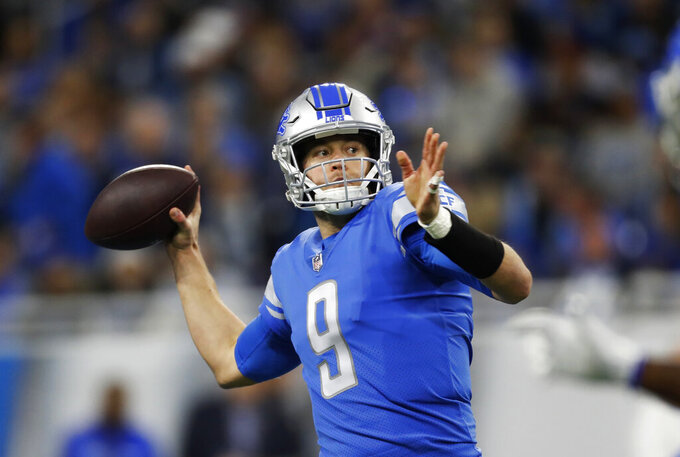 FILE - In this Dec. 23, 2018, file photo, Detroit Lions quarterback Matthew Stafford throws a pass during the first half of the team's NFL football game against the Minnesota Vikings in Detroit. Stafford has started since he was a rookie and after injuries stunted his first two seasons, the strong-arm quarterback has started every game for eight straight years. (AP Photo/Rey Del Rio, File)