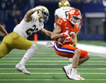 Notre Dame linebacker Drue Tranquill (23) prepares to wrap up Clemson wide receiver Hunter Renfrow (13) after a catch in the first half of the NCAA Cotton Bowl semi-final playoff football game, Saturday, Dec. 29, 2018, in Arlington, Texas. (AP Photo/Michael Ainsworth)