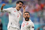 Spain's Jordi Alba celebrates with Alvaro Morata, left, after scoring the opening goal during the Euro 2020 soccer championship quarterfinal match between Switzerland and Spain at Saint Petersburg stadium in St. Petersburg, Russia, Friday, July 2, 2021. (AP Photo/Dmitri Lovetsky, Pool)