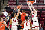 Oregon State forward Tres Tinkle (3) shoots as Stanford's Spencer Jones (14), Oscar da Silva (13) and James Keefe (22) defend during the first half of an NCAA college basketball game Thursday, Jan. 30, 2020, in Stanford, Calif. (AP Photo/John Hefti)