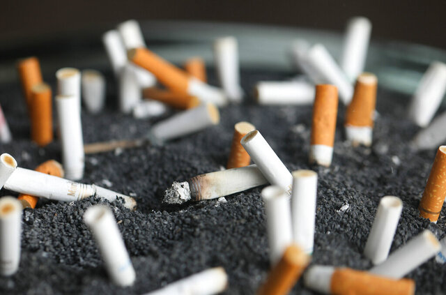 FILE - This March 28, 2019, file photo shows cigarette butts in an ashtray in New York. Moving company U-Haul has a new hiring policy and smokers need not apply. Starting this month the company will screen out people who use tobacco or nicotine when making new hires in certain U.S. states. (AP Photo/Jenny Kane, File)