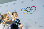 Sweden's Crown Princess Victoria, left, and Prince Daniel, right, react during the first day of the 134th Session of the International Olympic Committee (IOC), at the SwissTech Convention Centre, in Lausanne, Switzerland, Monday, June 24, 2019. The host city of the 2026 Olympic Winter Games will be decided during the134th IOC Session. Stockholm-Are in Sweden and Milan-Cortina in Italy are the two candidate cities for the Olympic Winter Games 2026. (Jean-Christophe Bott)/Keystone via AP)