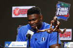Duke freshman Zion Williamson sits behind the Oscar Robertson Trophy at a news conference where he was awarded the U.S. Basketball Writers Association College Player of the Year award at the Final Four NCAA college basketball tournament, Friday, April 5, 2019, in Minneapolis. (AP Photo/Charlie Neibergall)