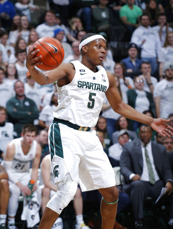 Michigan State's Cassius Winston looks for teammates during the first half of an NCAA college basketball game against Indiana, Saturday, Feb. 2, 2019, in East Lansing, Mich. (AP Photo/Al Goldis)