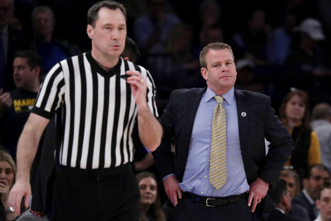 Marquette head coach Steve Wojciechowski, right, looks in the direction of official James Breeding during the second half of an NCAA college basketball semifinal game against Seton Hall in the Big East men's tournament, Friday, March 15, 2019, in New York. Seton Hall won 81-79. (AP Photo/Julio Cortez)