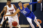 BYU forward Gavin Baxter (25) and Pepperdine forward Kessler Edwards (15) chase the ball during the first half of an NCAA college basketball game Saturday, Feb. 29, 2020, in Malibu, Calif. (AP Photo/Ringo H.W. Chiu)