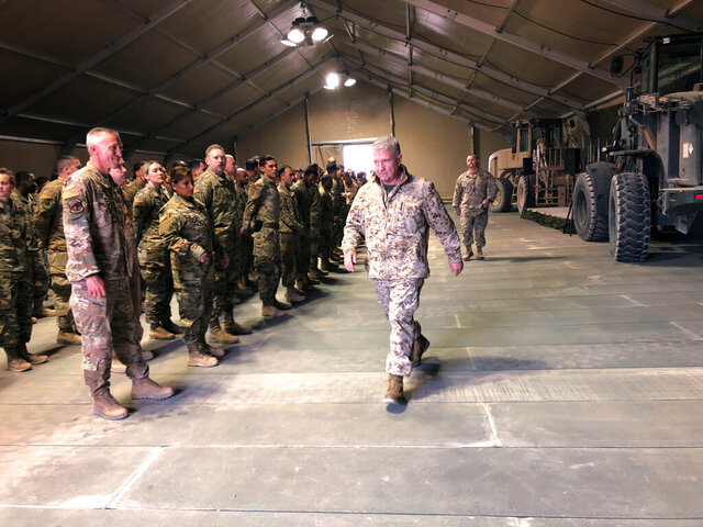 Marine Gen. Frank McKenzie, the top U.S. commander for the Middle East, meets with troops at Prince Sultan Air Base in Saudi Arabia, Wednesday, Jan. 29, 2019, where America has recently deployed fighter jets, Patriot missile batteries, troops and other systems. (AP Photos/Lolita Baldor)