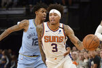 Phoenix Suns forward Kelly Oubre Jr. (3) handles the ball ahead of Memphis Grizzlies guard Ja Morant (12) in the second half of an NBA basketball game Sunday, Jan. 26, 2020, in Memphis, Tenn. (AP Photo/Brandon Dill)
