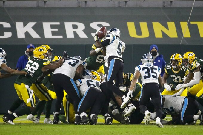 Green Bay Packers' Krys Barnes knocks the ball away from Carolina Panthers' Teddy Bridgewater at the goal line during the first half of an NFL football game Saturday, Dec. 19, 2020, in Green Bay, Wis. The Packers recovered the fumble. (AP Photo/Mike Roemer)