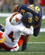 California's Aaron Maldonado, right, sacks Idaho State quarterback Tanner Gueller (4) during the second half of an NCAA college football game Saturday, Sept. 15, 2018, in Berkeley, Calif. (AP Photo/Ben Margot)