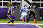 Minnesota Vikings wide receiver Adam Thielen, left, catches a 3-yard touchdown pass ahead of Dallas Cowboys defensive back Rashard Robinson, right, during the second half of an NFL football game, Sunday, Nov. 22, 2020, in Minneapolis. (AP Photo/Bruce Kluckhohn)
