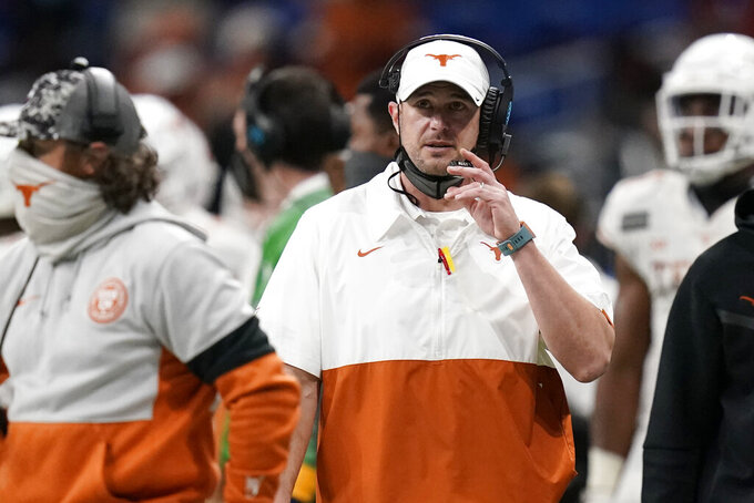 Texas coach Tom Herman watches from the sideline during the first half of the team's Alamo Bowl NCAA college football game against Colorado, Tuesday, Dec. 29, 2020, in San Antonio. (AP Photo/Eric Gay)