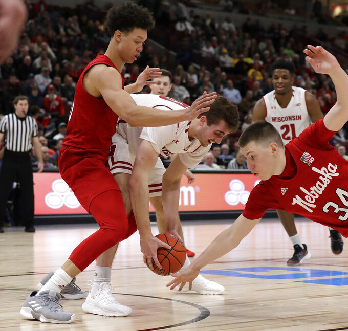 Wisconsin's Nate Reuvers, center, battles for a loose ball against Nebraska's Isaiah Roby and Thorir Thorbjarnarson (34) during the second half of an NCAA college basketball game in the quarterfinals of the Big Ten Conference tournament, Friday, March 15, 2019, in Chicago. Wisconsin won 66-62. (AP Photo/Nam Y. Huh)