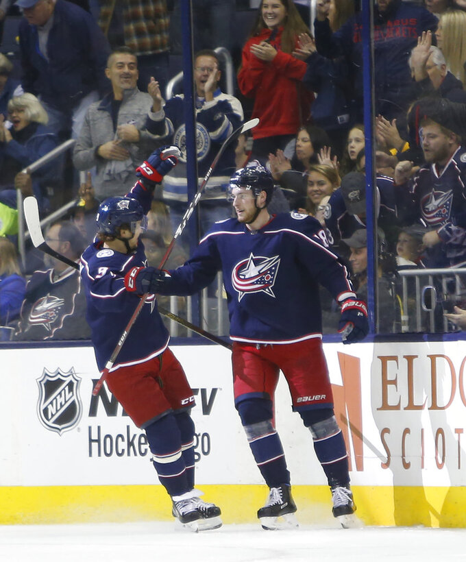 Columbus Blue Jackets' Pierre-Luc Dubois, right, celebrates his goal against the Buffalo Sabres with teammate Artemi Panarin, of Russia, during the first period of an NHL hockey game Saturday, Oct. 27, 2018, in Columbus, Ohio. (AP Photo/Jay LaPrete)