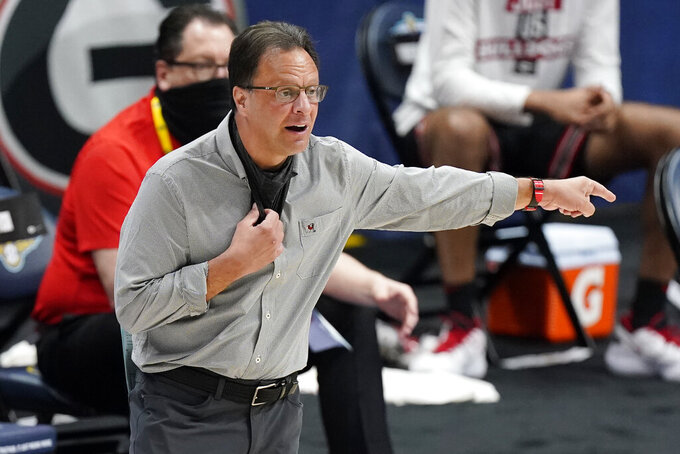 Georgia head coach Tom Crean directs his players in the second half of an NCAA college basketball game against Missouri in the Southeastern Conference Tournament Thursday, March 11, 2021, in Nashville, Tenn. (AP Photo/Mark Humphrey)