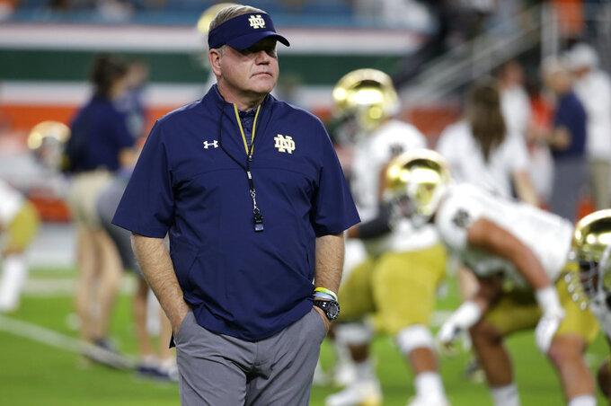 FILE - In this Nov. 11, 2017, file photo, Notre Dame head coach Brian Kelly walks on the field before an NCAA college football game against Miami in Miami Gardens, Fla. Notre Dame hosts Michigan on Saturday, Sept. 1, to open the college football season. (AP Photo/Lynne Sladky, File)