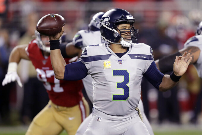 FILE - In this Nov. 11, 2019, file photo, Seattle Seahawks quarterback Russell Wilson (3) passes against the San Francisco 49ers during the first half of an NFL football game in Santa Clara, Calif. Continuing his successful run since becoming a starter as a rookie in 2012, Wilson is one of many leading contenders for the AP MVP award. (AP Photo/Ben Margot, File)
