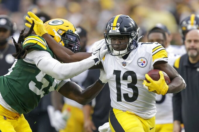 Pittsburgh Steelers' James Washington runs past Green Bay Packers' Za'Darius Smith during the first half of an NFL football game Sunday, Oct. 3, 2021, in Green Bay, Wis. (AP Photo/Matt Ludtke)